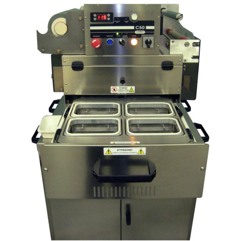 Macchina Termosaldatrice Compac C50CF con Formato Serie G a cassetto aperto