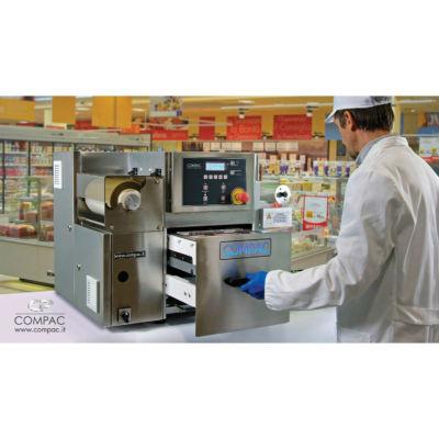 Sistema C26T Compac per il confezionamento di alimenti in atmosfera protettiva al banco del supermercato - cassetto aperto